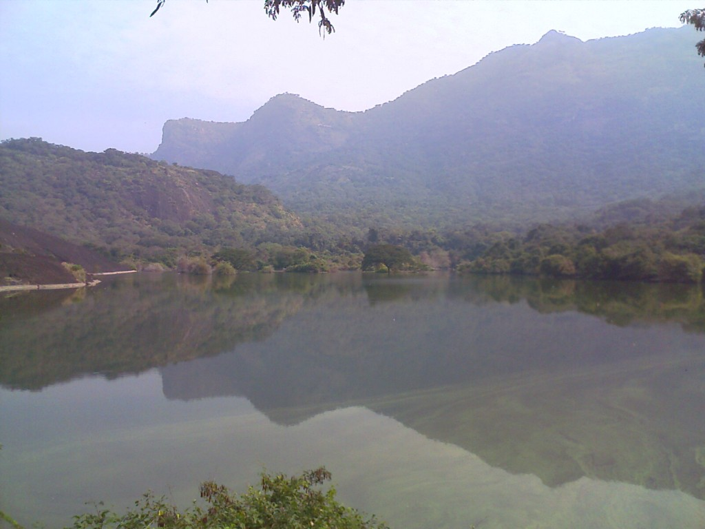 The shadow of mountains on the lake near monkey falls, Pollachi Coimbatore
