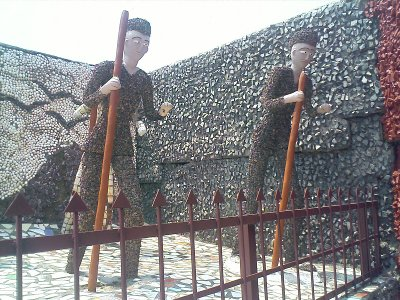 rock gardens palakkad - statues of people with stick - modern art